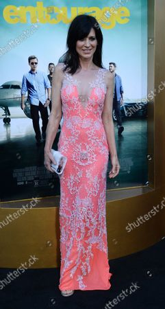 """Cast member Perrey Reeves attends the premiere of the motion picture comedy """"Entourage"""" at the Regency Village Theatre in the Westwood section of Los Angeles on June 1, 2015. Storyline: Movie star Vincent Chase, together with his boys Eric, Turtle, and Johnny, are back - and back in business with super agent-turned-studio head Ari Gold on a risky project that will serve as Vince's directorial debut."""