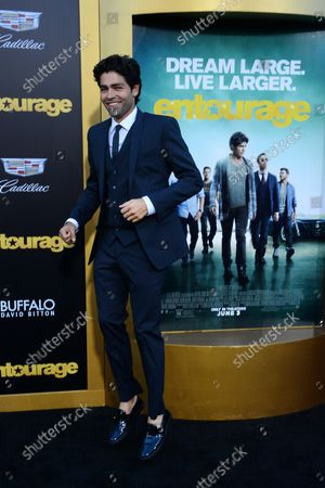 """Cast member Adrian Grenier attends the premiere of the motion picture comedy """"Entourage"""" at the Regency Village Theatre in the Westwood section of Los Angeles on June 1, 2015. Storyline: Movie star Vincent Chase, together with his boys Eric, Turtle, and Johnny, are back - and back in business with super agent-turned-studio head Ari Gold on a risky project that will serve as Vince's directorial debut."""