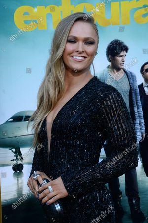 """Cast member Ronda Rousey attends the premiere of the motion picture comedy """"Entourage"""" at the Regency Village Theatre in the Westwood section of Los Angeles on June 1, 2015. Storyline: Movie star Vincent Chase, together with his boys Eric, Turtle, and Johnny, are back - and back in business with super agent-turned-studio head Ari Gold on a risky project that will serve as Vince's directorial debut."""