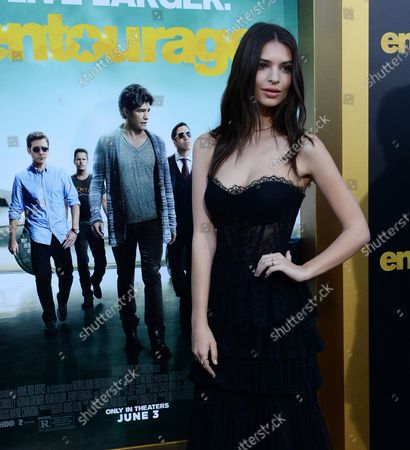"""Cast member Emily Ratajkowski attends the premiere of the motion picture comedy """"Entourage"""" at the Regency Village Theatre in the Westwood section of Los Angeles on June 1, 2015. Storyline: Movie star Vincent Chase, together with his boys Eric, Turtle, and Johnny, are back - and back in business with super agent-turned-studio head Ari Gold on a risky project that will serve as Vince's directorial debut."""