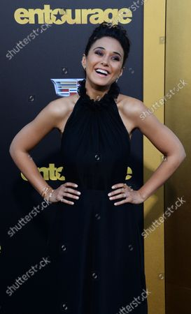 """Cast member Emmanuelle Chriqui attends the premiere of the motion picture comedy """"Entourage"""" at the Regency Village Theatre in the Westwood section of Los Angeles on June 1, 2015. Storyline: Movie star Vincent Chase, together with his boys Eric, Turtle, and Johnny, are back - and back in business with super agent-turned-studio head Ari Gold on a risky project that will serve as Vince's directorial debut."""