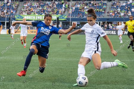 Alana Cook (4 OL Reign) against Sophia Smith (9 Portland Thorns) during the National Womens Soccer League game between OL Reign v Portland Thorns at Lumen Field in Seattle, Washington.