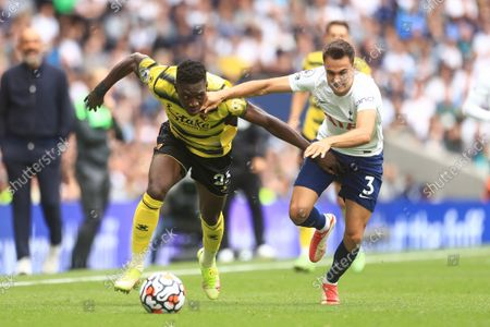 Watford's Ismaila Sarr takes on Tottenham's Sergio Reguilon during the English Premier League soccer match between Tottenham Hotspur and Watford at the Tottenham Stadium in London, England, in London, England