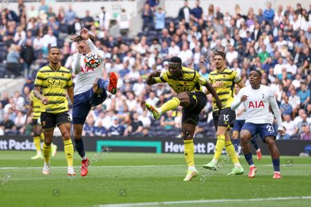 Watford's Ismaila Sarr clears the ball onto Tottenham's Dele Alli during the English Premier League soccer match between Tottenham Hotspur and Watford at the Tottenham Stadium in London, England, in London, England