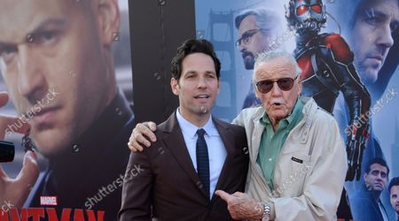 """Cast ember Paull Rudd (L) and comic book icon Stan Lee attend the premiere of the sci-fi motion picture """"Ant-Man"""" at the Dolby Theatre in the Hollywood section of Los Angeles on June 29, 2015. Storyline: Armed with a super-suit with the astonishing ability to shrink in scale but increase in strength, con-man Scott Lang (Rudd) must embrace his inner hero and help his mentor, Dr. Hank Pym (Michael Douglas), plan and pull off a heist that will save the world."""