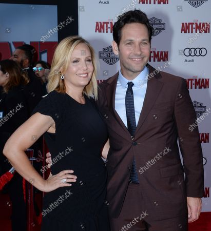 """Cast ember Paul Rudd and his wife, television producer Julie Yaeger attend the premiere of the sci-fi motion picture """"Ant-Man"""" at the Dolby Theatre in the Hollywood section of Los Angeles on June 29, 2015. Storyline: Armed with a super-suit with the astonishing ability to shrink in scale but increase in strength, con-man Scott Lang (Rudd) must embrace his inner hero and help his mentor, Dr. Hank Pym (Michael Douglas), plan and pull off a heist that will save the world."""