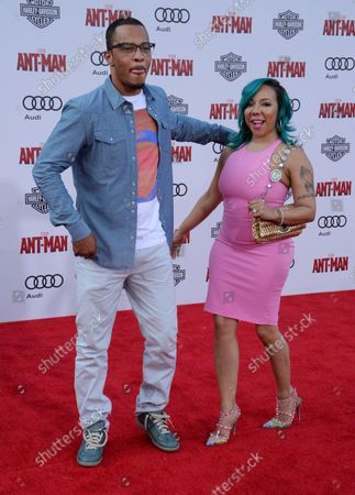 """Cast member T.I. and his wife, singer Tamika 'Tiny' Cottle-Harris attends the premiere of the sci-fi motion picture """"Ant-Man"""" at the Dolby Theatre in the Hollywood section of Los Angeles on June 29, 2015. Storyline: Armed with a super-suit with the astonishing ability to shrink in scale but increase in strength, con-man Scott Lang (Paul Rudd) must embrace his inner hero and help his mentor, Dr. Hank Pym (Michael Douglas), plan and pull off a heist that will save the world."""