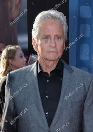 """Cast member Michael Douglas attends the premiere of the sci-fi motion picture """"Ant-Man"""" at the Dolby Theatre in the Hollywood section of Los Angeles on June 29, 2015. Storyline: Armed with a super-suit with the astonishing ability to shrink in scale but increase in strength, con-man Scott Lang (Paul Rudd) must embrace his inner hero and help his mentor, Dr. Hank Pym (Douglas), plan and pull off a heist that will save the world."""