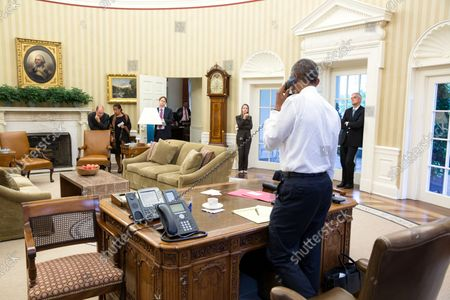 President Barack Obama talks on the phone with Secretary of State John Kerry regarding the Iran nuclear agreement in the Oval Office, July 13, 2015. Attending from left: Ben Rhodes, Deputy National Security Advisor for Strategic Communications, National Security Advisor Susan E. Rice, Jeffrey Prescott, Senior Director for Iran, Iraq, Syria, and the Gulf States, Avril Haines, Deputy National Security Advisor Counterterrorism and Chief of Staff Denis McDonough.   The Iran Nuclear agreement was announced on July 14, 2015.    Official White House