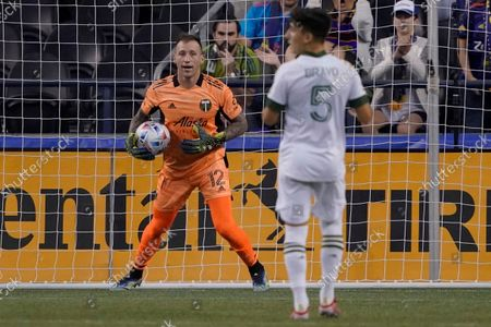Portland Timbers goalkeeper Steve Clark (12) holds the ball after making a stop against the Seattle Sounders during the first half of an MLS soccer match, in Seattle. The Timbers won 2-0