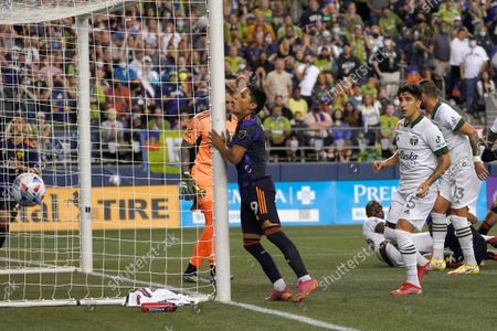 Seattle Sounders forward Raul Ruidiaz (9) reacts after a shot on goal against the Portland Timbers went wide during the second half of an MLS soccer match, in Seattle. The Timbers won 2-0