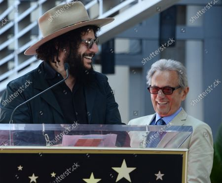 Music pioneer and recording engineer Al Schmitt (R) listens to comments by musician Don Was during an unveiling ceremony honoring Schmitt with the 2,557th star on the Hollywood Walk of Fame in Los Angeles on August 13, 2015.