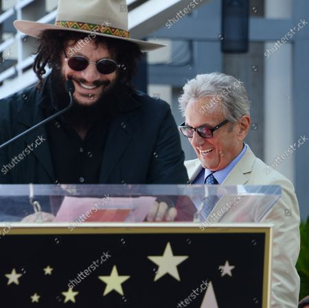 Music pioneer and recording engineer Al Schmitt (R) reacts to comments by musician Don Was during an unveiling ceremony honoring Schmitt with the 2,557th star on the Hollywood Walk of Fame in Los Angeles on August 13, 2015.