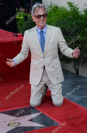 Music pioneer and recording engineer Al Schmitt poses next to his star during an unveiling ceremony honoring him with the 2,557th star on the Hollywood Walk of Fame in Los Angeles on August 13, 2015.