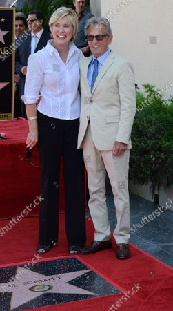 Music pioneer and recording engineer Al Schmitt (R) poses with his wife Lisa during an unveiling ceremony honoring Schmitt with the 2,557th star on the Hollywood Walk of Fame in Los Angeles on August 13, 2015.