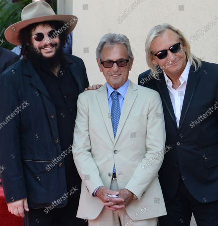Music pioneer and recording engineer Al Schmitt (C) poses with musicians Don Was (L) and Joe Walsh during an unveiling ceremony honoring Schmitt with the 2,557th star on the Hollywood Walk of Fame in Los Angeles on August 13, 2015.