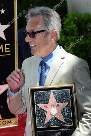 Music pioneer and recording engineer Al Schmitt holds a replica plaque during an unveiling ceremony honoring him with the 2,557th star on the Hollywood Walk of Fame in Los Angeles on August 13, 2015.