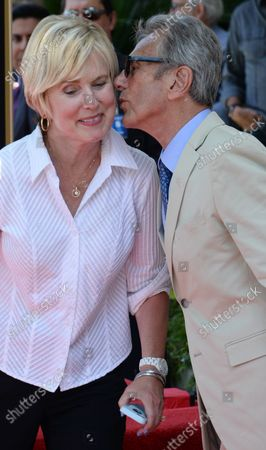 Music pioneer and recording engineer Al Schmitt kisses his wife Lisa during an unveiling ceremony honoring Schmitt with the 2,557th star on the Hollywood Walk of Fame in Los Angeles on August 13, 2015.