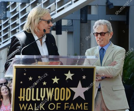 Music pioneer and recording engineer Al Schmitt (R) listens to comments by musician Joe Walsh during an unveiling ceremony honoring Schmitt with the 2,557th star on the Hollywood Walk of Fame in Los Angeles on August 13, 2015.