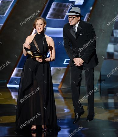 Actress Joan Cusack (L) and actor Bradley Whitford onstage during the 67th Primetime Emmy Awards in the Microsoft Theater in Los Angeles on September 20, 2015.