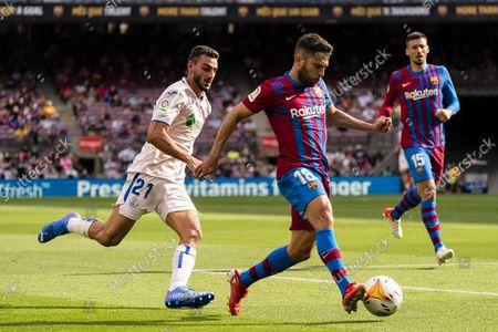 (210830) - BARCELONA, Aug 30, 2021 (Xinhua) - Barcelona's Jordi Alba (R) lives with Getafe's Juan Iglesias during the Spanish league football match between FC Barcelona and Getafe CF in Barcelona, Spain, on Aug 29, 2021.