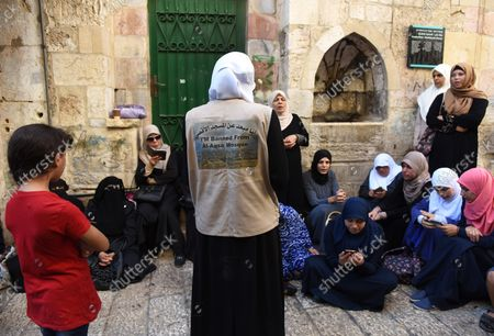 """A Palestinian woman from the Mourabitat group, wears a vest that reads """"I'm banned from the Al-Aqsa""""  at a protest against Jewish groups visiting the Al-Aqsa Mosque compound and for being banned from their holy site in the Old City of Jerusalem, September 22, 2015. Israeli Defense Minister Moshe Ya'alon outlawed the group of women and issued an order to forbid the Mourabitat group to enter the compound in Jerusalem's Old City that Muslim's call the Noble Sanctuary, or Al-Aqsa, and the Jews call the Temple Mount."""