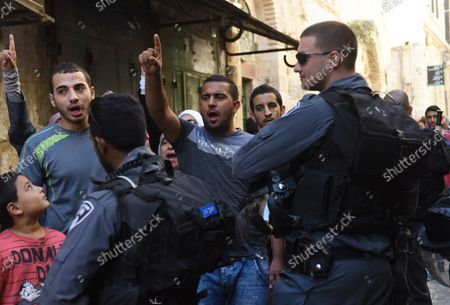 Israeli border police guard supporters of the Muslim women's group, the Mourabitat group, as they shout slogans  at a protest against Jewish groups visiting the Al-Aqsa Mosque compound and for being banned from their holy site in the Old City of Jerusalem, September 22, 2015. Israeli Defense Minister Moshe Ya'alon outlawed the group of women and issued an order to forbid the Mourabitat group to enter the compound in Jerusalem's Old City that Muslim's call the Noble Sanctuary, or Al-Aqsa, and the Jews call the Temple Mount.