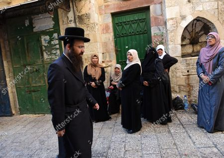 Muslim women, from the Mourabitat group, shout at an Ultra-Orthodox Jew as he passes, at a protest against Jewish groups visiting the Al-Aqsa Mosque compound and for being banned from their holy site in the Old City of Jerusalem, September 22, 2015. Israeli Defense Minister Moshe Ya'alon outlawed the group of women and issued an order to forbid the Mourabitat group to enter the compound in Jerusalem's Old City that Muslim's call the Noble Sanctuary, or Al-Aqsa, and the Jews call the Temple Mount.