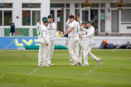 WICKET - Chris Wright is congratulated on the wicket of Jordan Cox during the LV= Insurance County Championship Division 3 match between Leicestershire County Cricket Club and Kent County Cricket Club at the Uptonsteel County Ground, Leicester