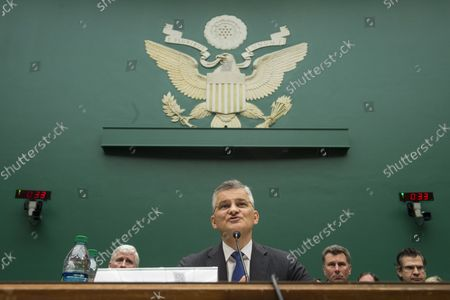 """Michael Horn, Volkswagen U.S. CEO, testifies on Volkswagen's emissions cheating allegations during a House Energy and Commerce Committee's Oversight and Investigations Subcommittee hearing, on Capitol Hill in Washington, D.C. on October 8, 2015. Horn apologized for the company's emissions scandal and said the company would accept """"full responsibility"""" for fitting software on diesel cars that tricked regulators."""