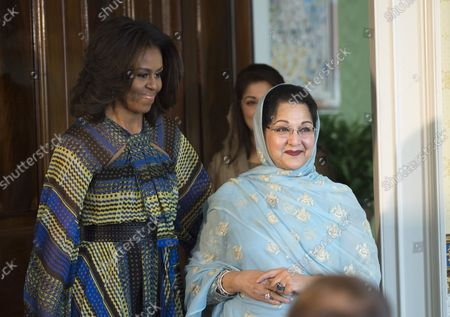 """First Lady Michelle Obama escorts  Kalsoom Nawaz Sharif, spouse of Pakistani Prime Minister Nawaz Sharif and  Mariam Safdar, daughter of Pakistan Prime Minister Nawaz Sharif,  during event in support of the """"Let's Girls Learn"""" initiative in the Blue Room of the White House in Washington, DC on October 22, 2015.  The First Lady announced a new partnership to further adolescent girls' education in Pakistan."""