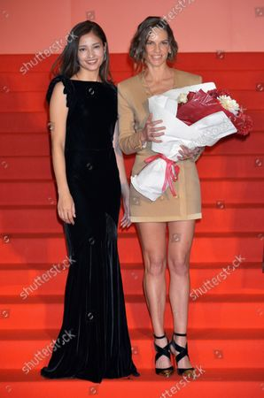 """Stock Image of Actress Hilary Swank(R) and Japanese actress Meisa Kuroki attend a stage greeting for the film """"You're Not You"""" in Tokyo, Japan on October 23, 2015."""