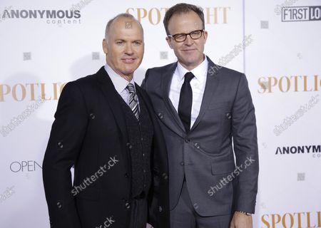 Michael Keaton and Thomas McCarthy arrive on the red carpet at the 'Spotlight' New York premiere at the Ziegfeld Theatre on October 27, 2015 in New York City.