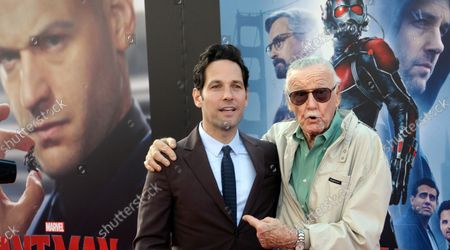 """Cast ember Paul Rudd (L) and comic book icon Stan Lee attend the premiere of the sci-fi motion picture """"Ant-Man"""" at the Dolby Theatre in the Hollywood section of Los Angeles on June 29, 2015. Storyline: Armed with a super-suit with the astonishing ability to shrink in scale but increase in strength, con-man Scott Lang (Rudd) must embrace his inner hero and help his mentor, Dr. Hank Pym (Michael Douglas), plan and pull off a heist that will save the world."""