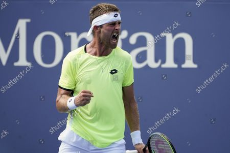 Stock Photo of Norbert Gombos, of Slovakia, reacts after scoring a point against Cristian Garin, of Chile, during the first round of the US Open tennis championships, in New York