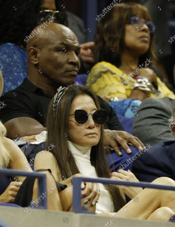 (L-R) Boxing great Mike Tyson designer Vera Wang and television personality Gayle King in the stands during the Opening Night Ceremony on the first day of the US Open Tennis Championships the USTA National Tennis Center in Flushing Meadows, New York, USA, 30 August 2021. The US Open runs from 30 August through 12 September.