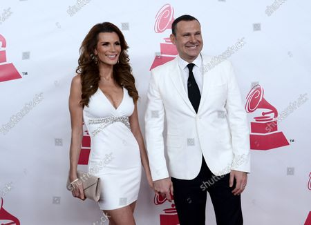 Actress Cristina Bernal (L) and TV personality Alan Tacher arrive for the Latin Recording Academy Person of the Year tribute to Brazilian singer/songwriter Roberto Carlos at the Mandalay Bay Convention Center in Las Vegas, Nevada on November 18, 2015.