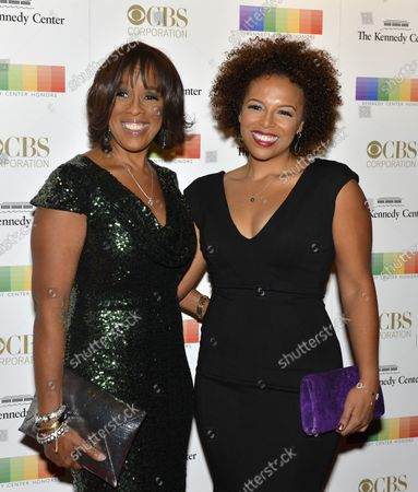 Television personality Gayle King (L) and daughter Kirby Bumpus arrive at the Kennedy Center for an evening of gala entertainment to honor the Kennedy Center Honorees, December 6, 2015, in Washington, DC.  The Honors are bestowed annually on five artists for their lifetime achievement in the arts and culture.