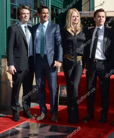 Actor Robe Lowe is joined by his wife joined by his wife Sheryl Berkoff and their sons Matthew  Edward Lowe (L) and John Owen Lowe (R) during an unveiling ceremony honoring him with the 2,567th star on the Hollywood Walk of Fame in Los Angeles on December 8, 2015.