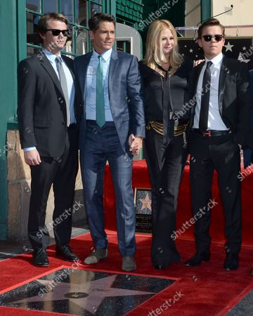 Stock Picture of Actor Robe Lowe is joined by his wife joined by his wife Sheryl Berkoff and their sons Matthew  Edward Lowe (L) and John Owen Lowe (R) during an unveiling ceremony honoring him with the 2,567th star on the Hollywood Walk of Fame in Los Angeles on December 8, 2015.