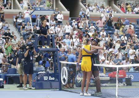 Sloane Stephens and Madison Keys embrace after match point where Stephens defeated Madison Keys in straight sets in Arthur Ashe Stadium in the first round of the 2021 US Open Tennis Championships at the USTA Billie Jean King National Tennis Center on Monday, August 30, 2021 in New York City.