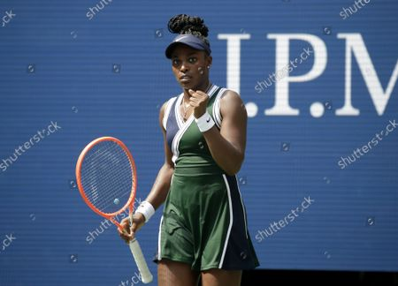 Sloane Stephens celebrates after match point defeating Madison Keys in straight sets in Arthur Ashe Stadium in the first round of the 2021 US Open Tennis Championships at the USTA Billie Jean King National Tennis Center on Monday, August 30, 2021 in New York City.