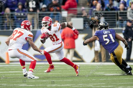 Kansas City Chiefs' wide receiver Jason Avant runs with the ball during the fourth quarter against the Baltimore Ravens at M&M Bank Stadium on December 20, 2015 in Baltimore, Maryland. Kansas City won the game 34-14.