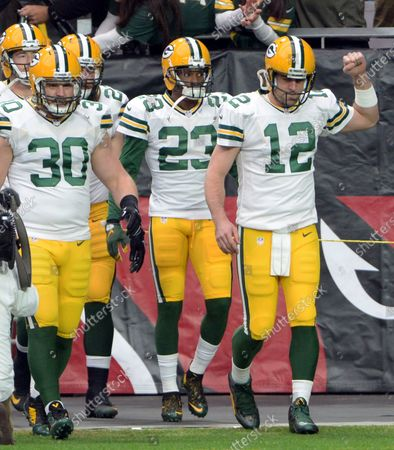 Green Bay Packers quarterback Aaron Rogers leads the team onto the field before the Packers-Arizona Cardinals game at University of Phoenix Stadium in Glendale, Arizona, December 27, 2015.