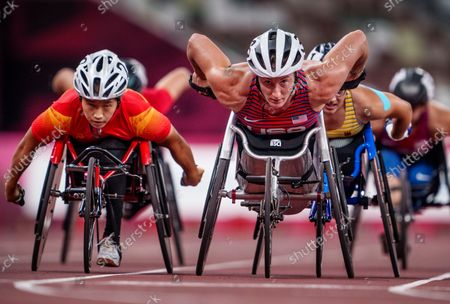 A handout photo made available by OIS/IOC shows Tatyana McFadden (C) of the USA competing in the women's 1,500m - T54 heats during the Athletics events of the Tokyo 2020 Paralympic Games at the Olympic Stadium in Tokyo, Japan, 30 August 2021.
