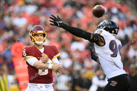 Washington Football Team quarterback Kyle Allen (8) in action against Baltimore Ravens linebacker Odafe Oweh (99) during the first half of a preseason NFL football game, in Landover, Md