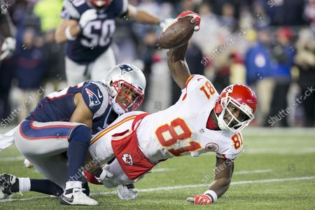 Kansas City Chiefs wide receiver Jason Avant (81) reaches for extra yardage as he is tackled by New England Patriots cornerback Logan Ryan (26) in the fourth quarter of the AFC Divisional Playoff game at Gillette Stadium in Foxborough, Massachusetts on January 16, 2016. The Patriots defeated the Chiefs, 27-20.