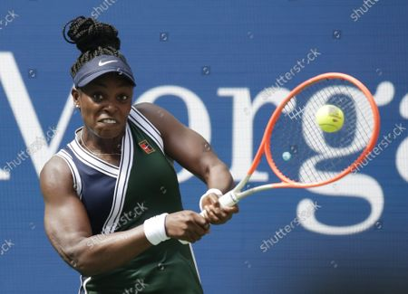 Sloane Stephens returns a ball in the second set before defeating Madison Keys in straight sets in Arthur Ashe Stadium in the first round of the 2021 US Open Tennis Championships at the USTA Billie Jean King National Tennis Center on Monday, August 30, 2021 in New York City.