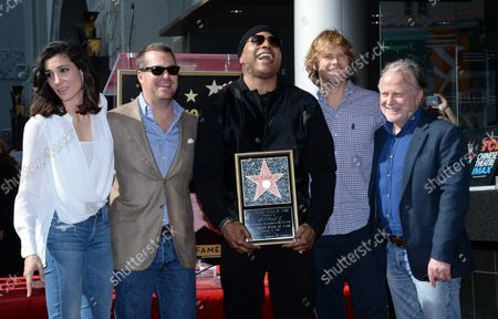Actors Daniela Ruah, Chris O'Donnell, LL Cool J, Eric Christian Olsen and producer Shane Brennan (L-R) gather during an unveiling ceremony honoring LL Cool J with the 2,571st star on the Hollywood Walk of Fame in Los Angeles on January 21, 2016.