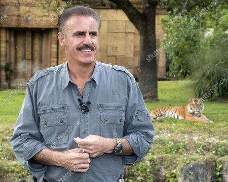 """Stock Image of Ron Magill, Director of Communications and Zoo Goodwill Ambassador conducts an interview following the introduction of Satu, a rare Sumatran Tiger at Zoo Miami in Miami, Florida on Jan 29, 2016. The cub, born on November 14, 2015, is the first for the Zoo and the second to be born in American zoos in 2015. The species is considered """"critically endangered"""" as under 500 are believed to exist in the forests of Sumatra and Indonesia. ."""